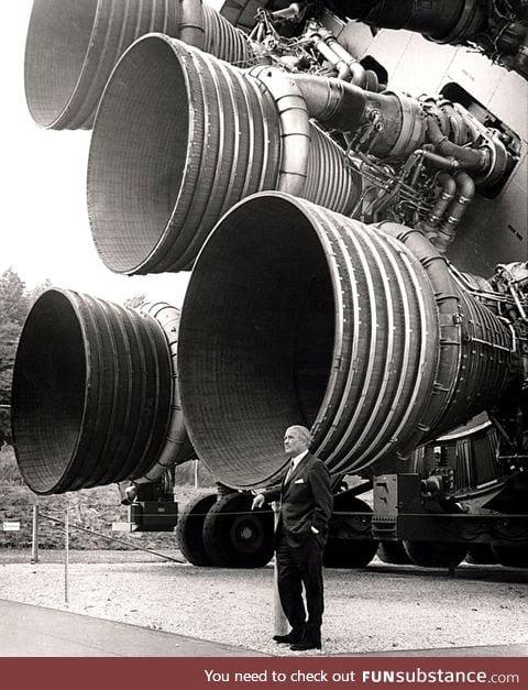 Wernher von Braun standing next to the F-1 engines of the Saturn V