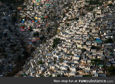 Large shanty town built onto a hillside in Haiti
