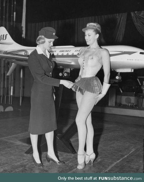 Scandinavian Stewardess examines a new uniform proposal for Scandinavian Airlines in 1964