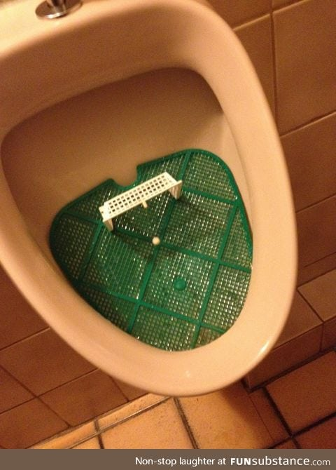 This urinal has a football minigame