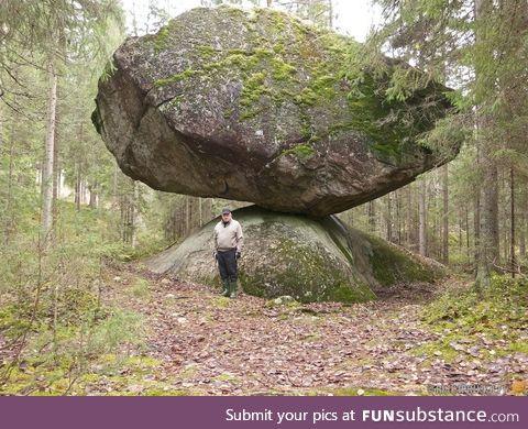 Kummakivi, the largest balancing rock megalith in Ruokolahti, Finland