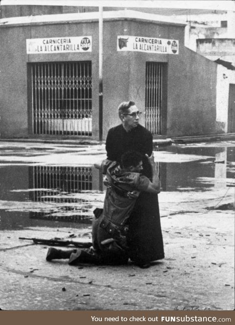 A priest consoling a dying soldier ad they are surrounded by snipers. Venezuela 1962