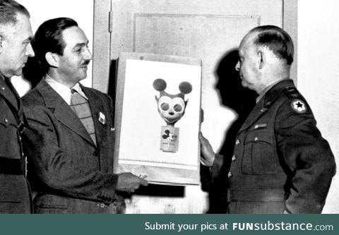 Walt Disney showing off the gas mask he designed for children during World War II