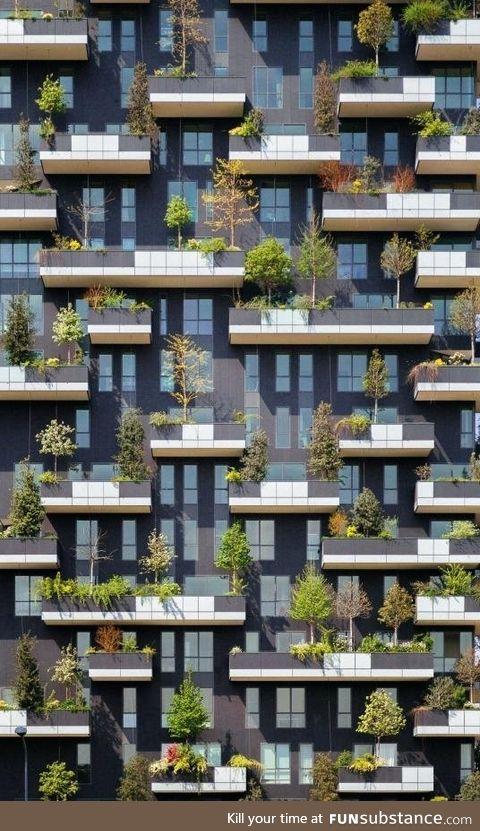 Trees adorn the balconies of this residential tower in Milan
