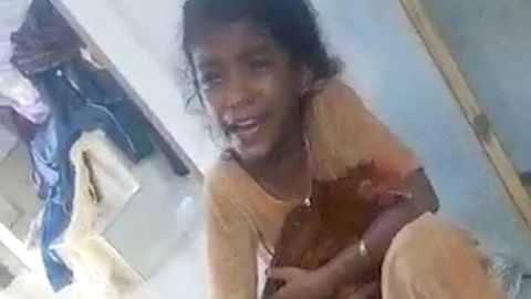 Compassionate Girl Protects a Chicken in India