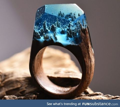 Snowy forest ring made out of wood and resin