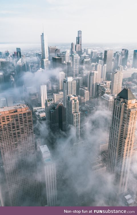 Chicago covered in clouds from 95 stories up.