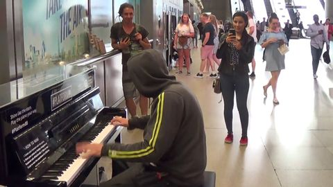 Construction worker kills it on the piano on the way home (watch the whole thing)