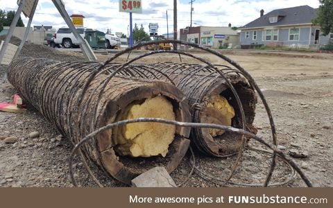 Construction crews working on a stretch of road uncovered old water pipes made of wood