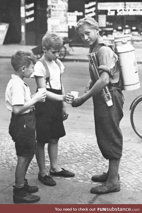 Boy with a portable lemonade stand, 1931