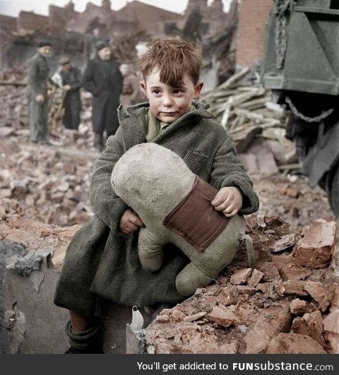 Colorised photo of an Abandoned Boy Holding a Stuffed Toy Animal. London 1945