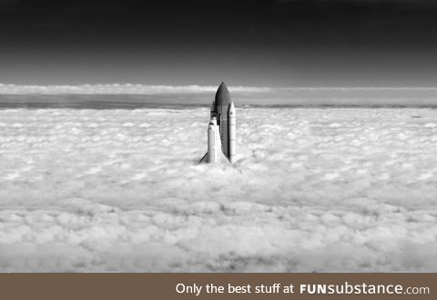 The space shuttle breaking through the clouds