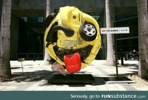 Artist Rudolf John, transformed a mangled car into an emoji as an anti texting