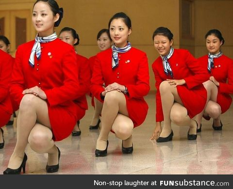Cathay Pacific flight attendents training elegance when squatting down