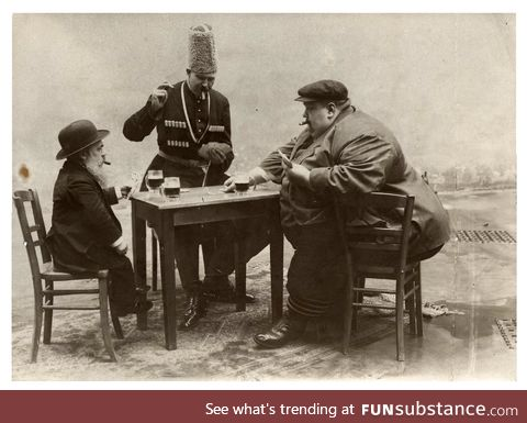 The shortest, tallest, and fattest men of Europe drinking and playing cards together 1913