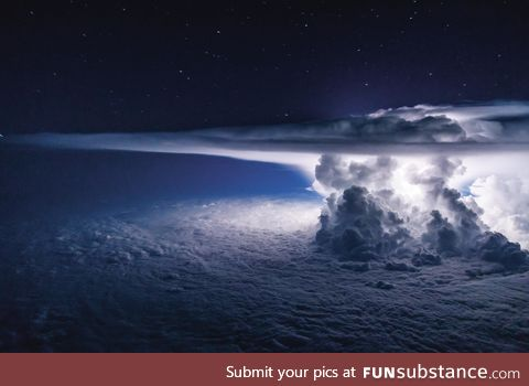 Thunderstorm above Pacific Ocean captured from a plane c*ckpit, by Santiago Borja