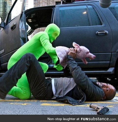 Will Smith being assaulted by a man with a hand puppet