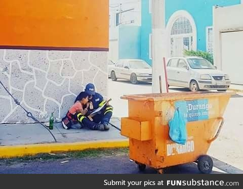 A father takes a break from his job to educate his son on the street