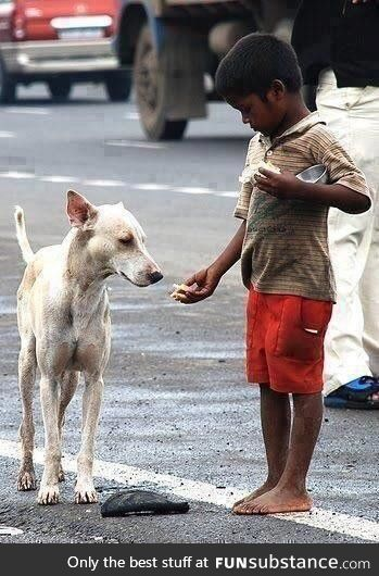 A boy that may not have much still shares with a dog