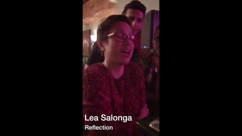 The voice of Mulan and Princess Jasmine, Lea Salonga, singing Reflection in a bar