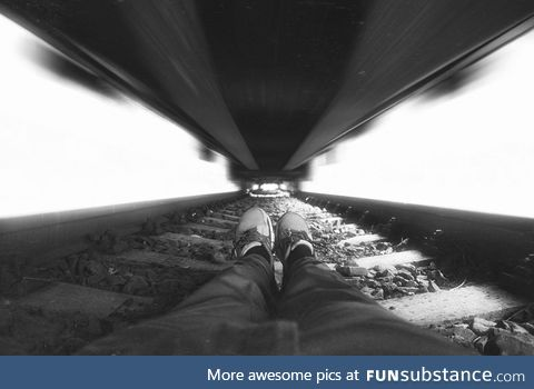 Photographer under train