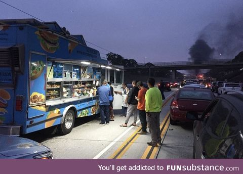 Taco truck start doing business during accident related traffic jam