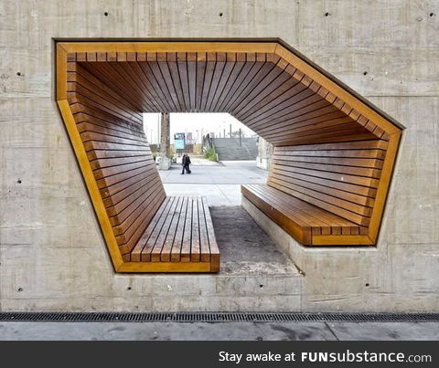 Wooden bench built into a concrete wall