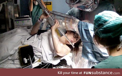 This Russian flutist playing Mozart as surgeons remove her brain tumor