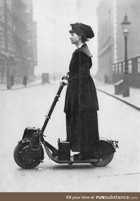 Lady Florence Norman, suffragette, going to work in London, on her electric scooter