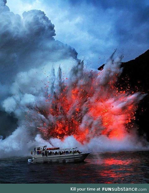 Lava exploding next to a tourist boat