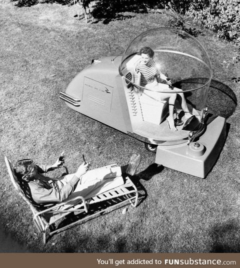 Luxury air conditioned lawn mower of the 1950's
