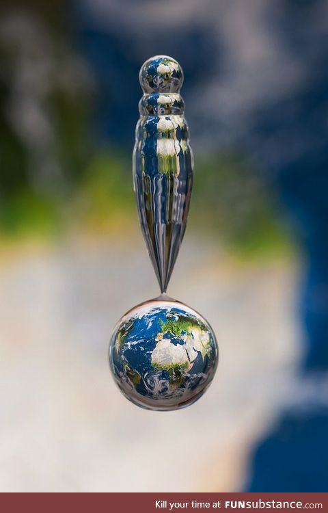 Water droplet captured above map of the earth
