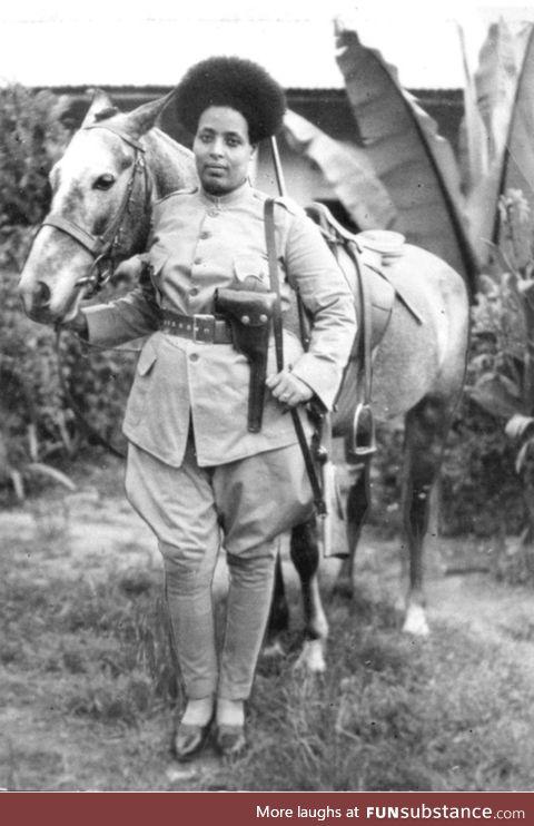 Ethiopian female soldier preparing to fight against Benito Mussolini's fascist Italy