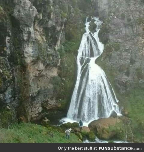 This waterfall looks like a woman in a dress