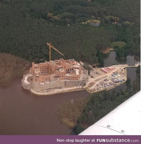 Some freak is building damn castle in the middle of nowhere