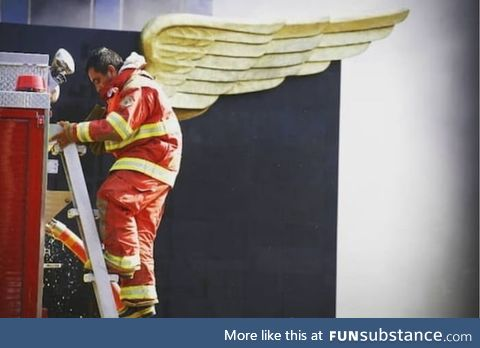 Photo of a fireman taken during the fire in DoñAna , Spain. Not all heroes wear
