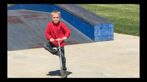 Adorable kid trying to impress some skateboarders