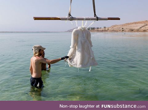 Artist leaves dress in the dead sea for 2 years and it turns into glittering salt crystal