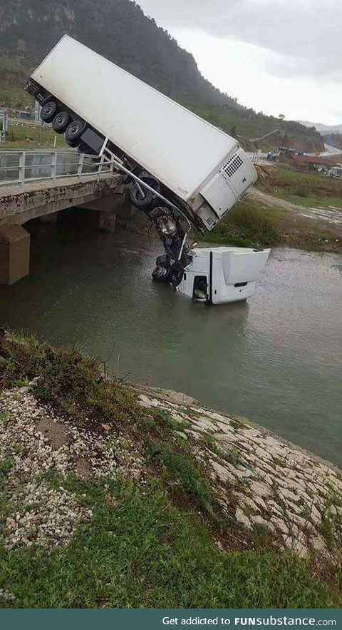 Here we see a rare photo of a truck in its natural habitat, drinking water from a river