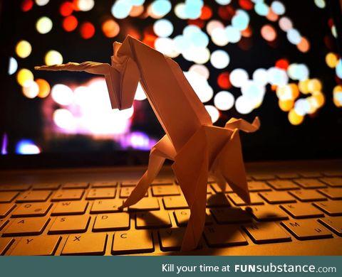 Say hi to my origami unicorn giraffe. He's on steroids, don't judge.