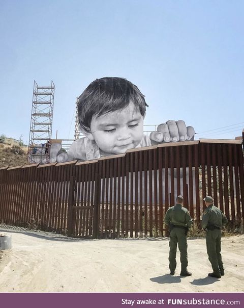 Street artist installs face of a child on Mexican side of the border wall