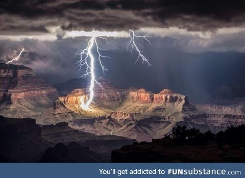 Grand Canyon getting lit only by a lightning stroke