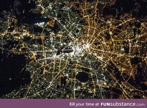 We can still somewhat see Berlin's east-west divide at night in the colour of light bulbs