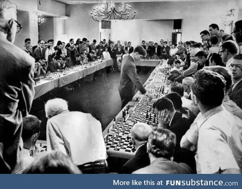 Bobby Fischer playing 50 opponents simultaneously, 1964. He won 47 of the matches, drew 2