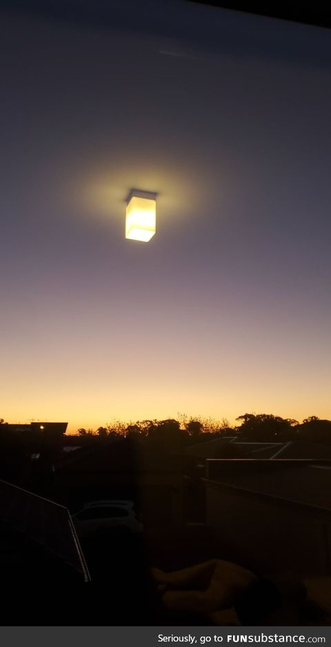 The view from my friend's room makes it look like his light is in the middle of the sky