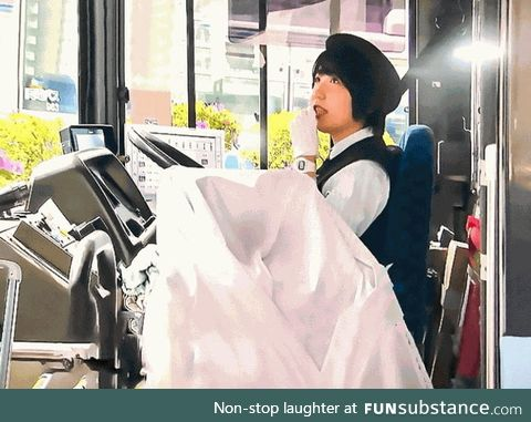 A white blanket over the fare machine. While on strike, bus drivers in Okayama, Japan,