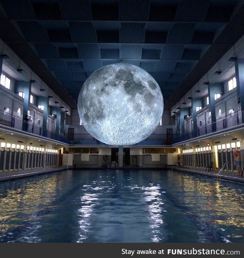 "The art installation ""Museum of the Moon"" at a swimming pool in Italy"