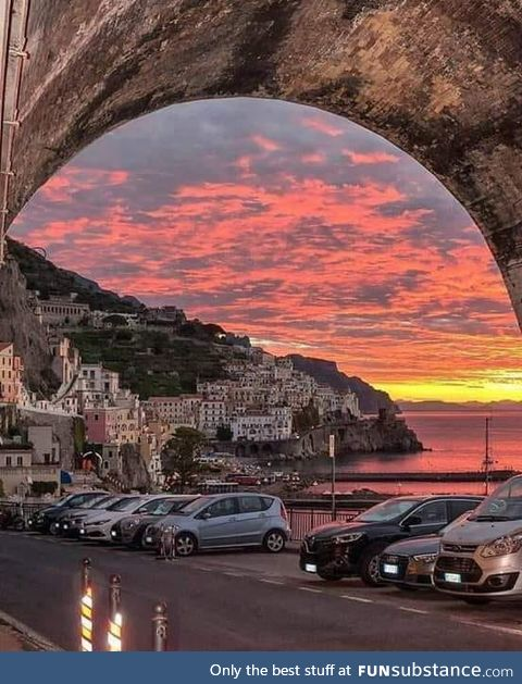 Under the bridge in the sunset, Amalfi, Italy