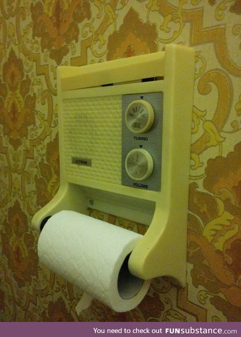 A toilet roll holder with a radio
