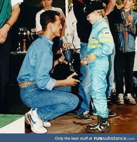 Michael Schumacher gives trophy to little Sebastian Vettel